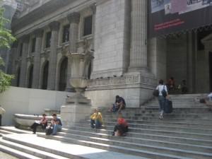 Steps to the 6th Avenue entrance of the New York Public Library. Just across the street, Jon and Mara have a fateful encounter with a certain assassin.